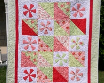 Single or large cot quilt or lap quilt.