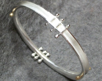 Hand Forged Sterling Silver Anticlastic Bangle with 14K Gold Accents, Sterling Silver Stacking Bracelet, Anticlastic Bangle