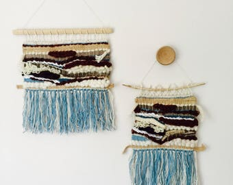 Neutral brown cream and turquoise woven wall hanging weaving.