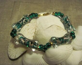Emerald Gold Swirl Bracelet