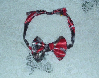 Boys & Men Red Camo Bow Ties Available in 19 camo colors. Select from option  for boys or men and option for camo color.Note neck size