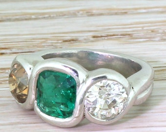 Retro Emerald, Fancy Orange & White Old Cut Diamond Three Stone Ring, circa 1945
