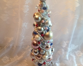 Elegant, Decorated bottle brush Christmas tree, mini christmas tree in sugar bowl