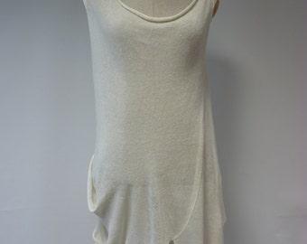 Sale, original price 60, new price 50. Transparent asymmetrical off-withe tunic, XL size.