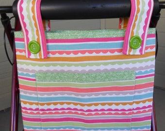 """Walker bag.  Walker Tote.  Bag for walker.  Beach Bag Bright stripes. Light green lining.  Velcro closure. 15""""W x 12""""H.  Front pocket."""