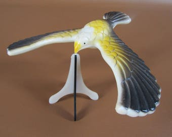 Plastic weighted balancing bird with stand