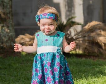 Kitenge flower baby sun dress, available in sizes from newborn to 24 months