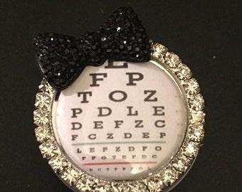 Eye doctor badge reel, bling bow Snellen eye chart, retractable badge holder, eye exam, reading glasses, human anatomy, visual symptoms