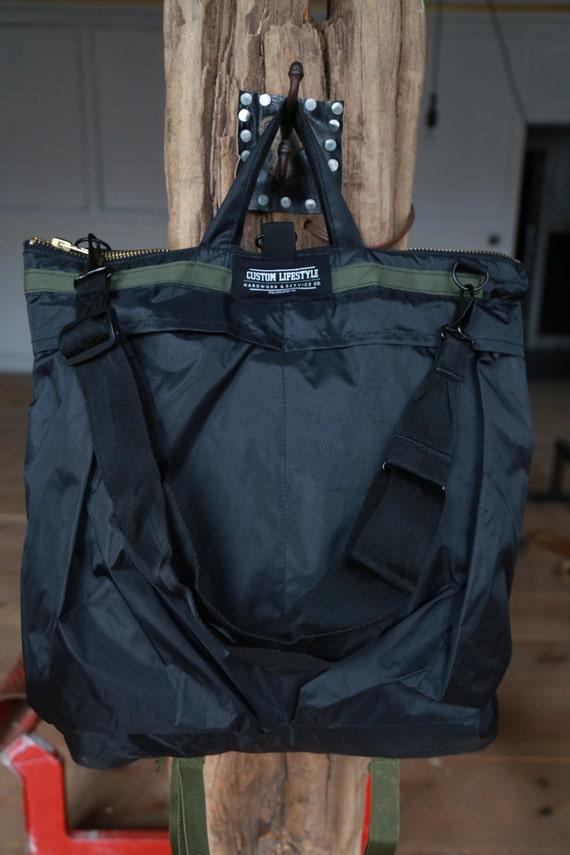 CL black and olive helmet bag