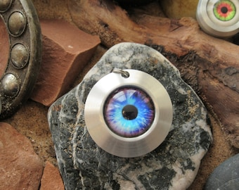 Handmade metalwork glass eye pendant