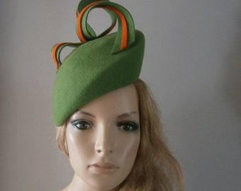 green wool felt perching beret style hat adorned with hand sculptured ribboned felt detail