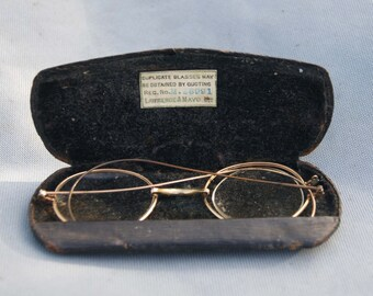 A pair of Lawrence and Mayo Eye Glasses in Case