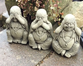 Three wise stone Buddhas see hear and speak no evil garden ornaments