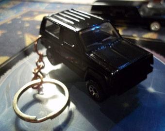 custom made very rare keychain 1984 to 1990 jeep cherokee xj,gloss black w/black grill-bumpers-chrome mags/repaint-mint