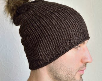 Hand knitted men's hat with furry pompom