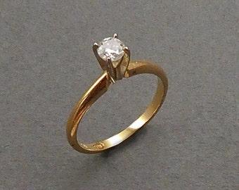 14K .25 pt diamond solitaire size 6