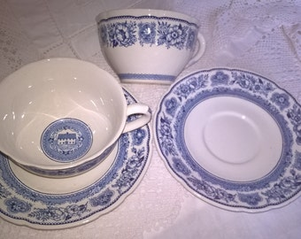 Pair of Wedgwood Yale cups and saucers. Inside the cup is the Branford Founders house, 1701. Cup and saucer rims have a floral pattern.
