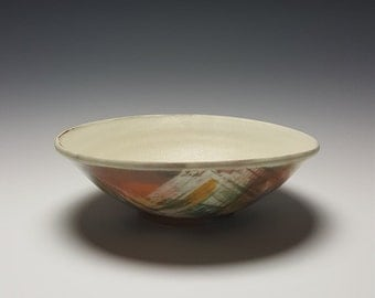 Handmade ceramic shallow bowl with colorful exterior by Potteryi.