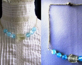Turn-of-neck blue - pale glass beads and a stone rock Quartz mounted chain fine silver