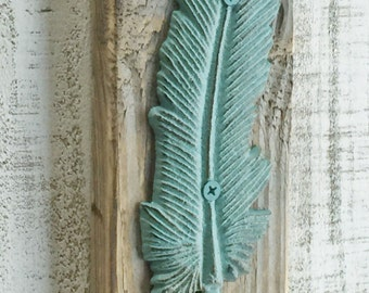 Cast Iron Distressed Aqua Metal Feather Wall Hook on Reclaimed Wood