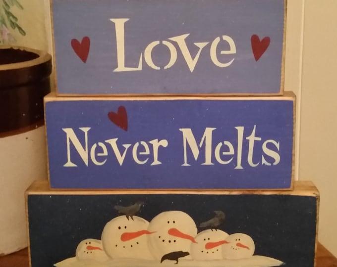 """Primitive Snowman """"Love Never Melts"""" Block Sign"""