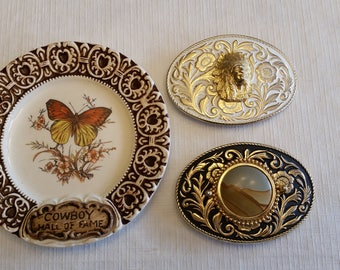 vintage cowboy hall of fame collector plate and 2 western belt buckles - indian head and desert sandstone - butterfly oklahoma collection