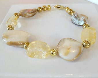 Gold and natural shell hand beaded bracelet