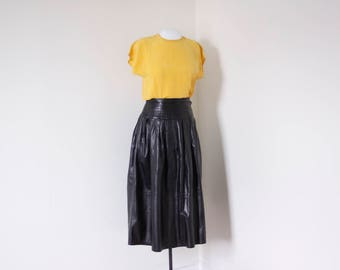 Black leather skirt, vintage A-line skirt with side-button closure and pockets, high waisted mad max midi skirt