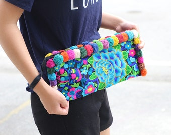 Long Wristlet Purse With Embroidered Fabric With Colorful Cotton Pompoms