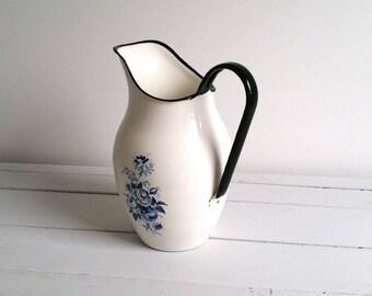 Beautiful enamel jug blue flower pattern black trim