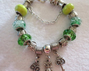 CLEARANCE!  Large hole green beads with owls on snake bracelet