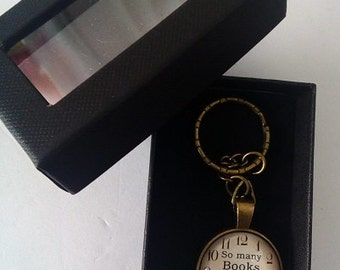 Retro Gold tone keyring for  book lovers,  clockface picture with  too many books so little time  quote.