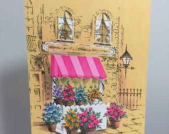 vintage unused greeting card // get well // cheery // flowers // street scene // feel better // wish // awning // yellow // pink