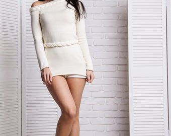 White/Cream asymmetric open shoulder pullover with pleated details and belt