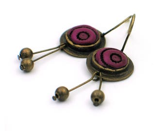 Long metal earrings , bronze,