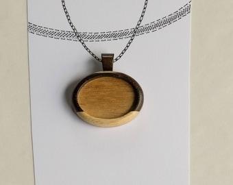 Fine finished hardwood bezel pendant - Walnut , maple and mahogany - 22 x 30 mm cavity - (A43c-X) - Organic bail