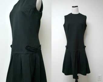"60s black poly pinafore . fits a large . 38"" bust"