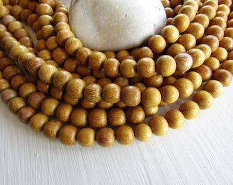 Nangka round wood beads  , natural yellow  wood, exotic supplies  from Philippines  9.5 mm to 10 mm  (40 beads ) 6ph14