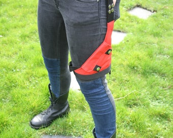 Thigh Holster, Garter Purse or Wallet, Extra Pocket with Red and Black Industrial Bondage Styling for Fetish, Clubwear, or Adventuring.