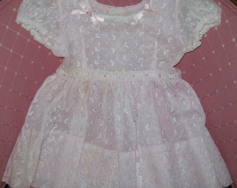 Vintage 1950's Pink eyelet dress for little girls.Size 3?Pink sash in back.Lined.Great for spring for that special little girl.Photo prop.