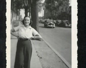 vintage 1940's photograph of confidant woman on the street-  showing great clothes and cars.  NOTE: shop holiday-ships September 1
