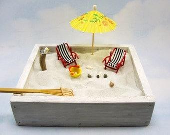 miniature zen beach garden kit, mini lounge chairs, shells, umbrella, seagull, driftwood, rake