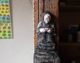 Knitting Woman Ceramic Wall Hanging