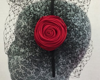 Carmen - blood red rolled ribbon rose with black veiling