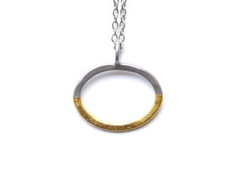 oval chrome pendant with gold leaf detail, 24 karat gold, half and half, modern pendant on gunmetal chain, silver pendant, silver chain