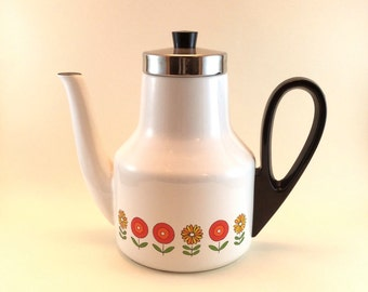 Vintage large white enamelware coffee pot with a decorative band of stylized flowers, chromed lid and black plastic handle