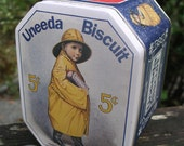 I Needa Uneeda Everyone Needs A Vintage Nabisco Biscuit Tin To Call Their Own - Boy in Yellow Raincoat and Sou'wester Metal Box