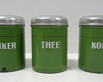 Set of three Dutch vintage enamel storage jars.