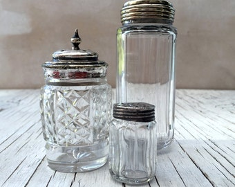 Vintage collection of 3 glass containers: vanity dressing table jar, two condiment jars, one with sterling silver top. Circa 1930s—1950s.