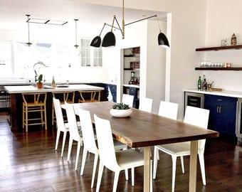 live edge black walnut dining table with satin brass 'u' shaped base